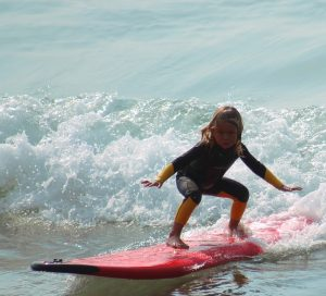 Little girl on the surf